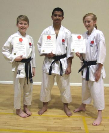 Chris Cooper, Niaaz Hoque and Eve Messenger celebrate achieving black belt status.
