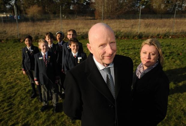 Castle Hill Junior School headteacher John Martin and deputy head Rebecca Willmouth with pupils at the site where the new Rooksdown Primary School will be built