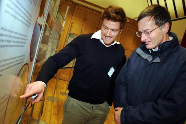 David Bryson, from Luminous Energy, chats to Alan Stevens right, at a public exhibition of plans for a solar farm in Overon