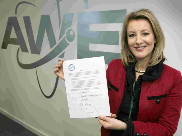 AWE's HR director Shan Martin, holding The 5% Club charter