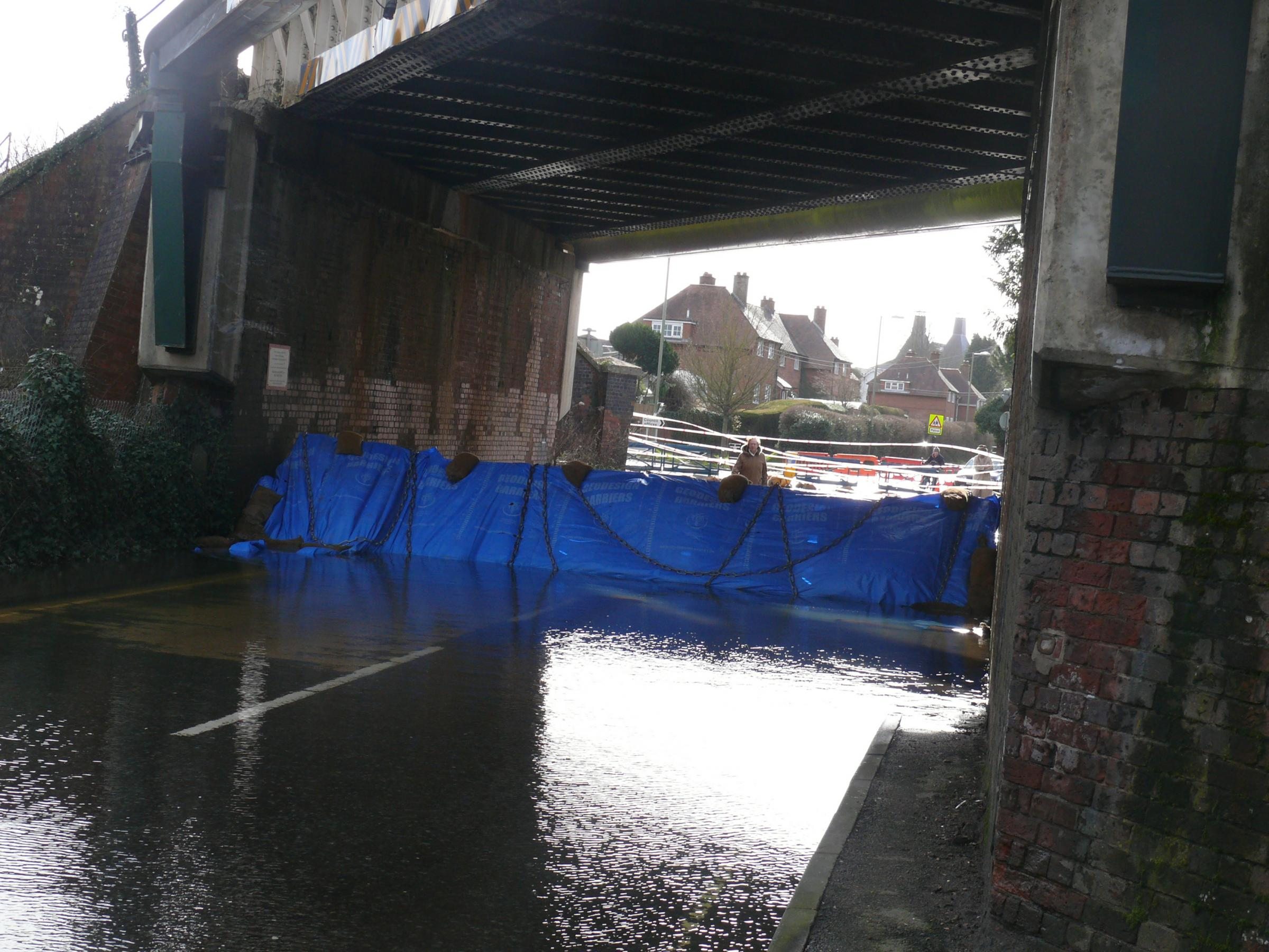Houses evacuated as floodwaters rise
