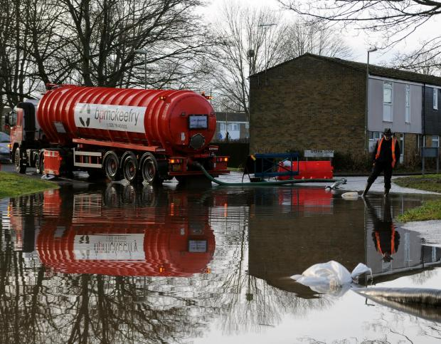A tanker tackles the flooding in Buckskin.
