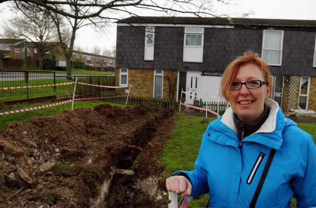 Janet Littlewood got a relative to dig a ditch in her garden in an attempt to ward off the flood water.