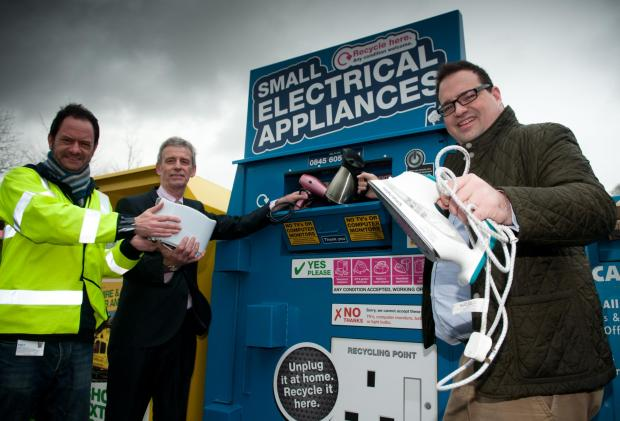 Councillor Robert Donnell, right, at a recycling bank.