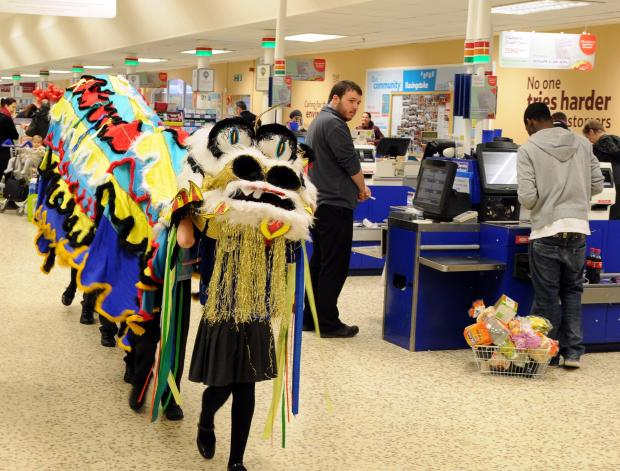 Pupils celebrate Chinese New Year by parading dragon in Tesco