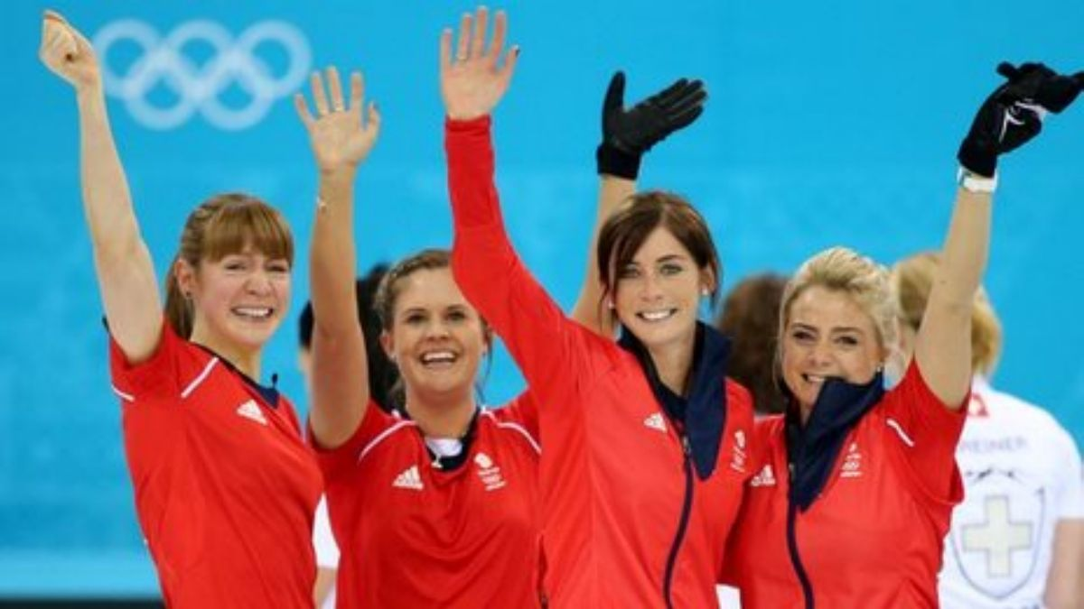 Eve Muirhead and her team celebrate their bronze medal.
