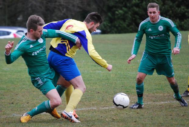 Players from CI (yellow) and Republic of Chineham battle for the ball.