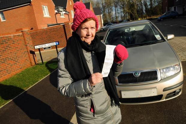 Enid Tait with the parking ticket she got while visiting her daughter in St Mary's Park, Hartley Wintney.