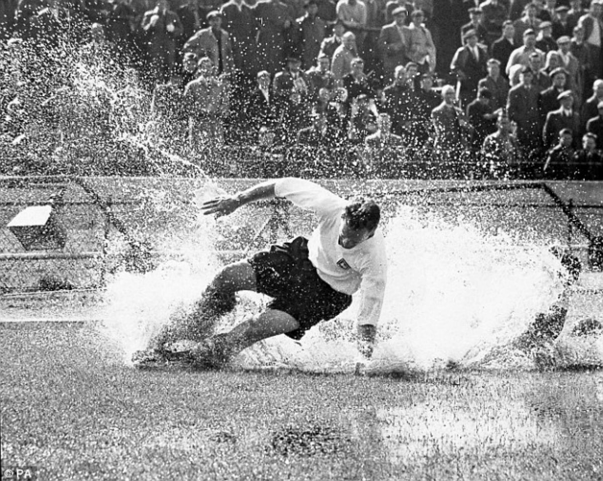This picture of Sir Tom Finney in action at a waterlogged Stamford Bridge has become an iconic image.