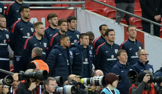The four Saints pictured on the England bench prior to last night's friendly