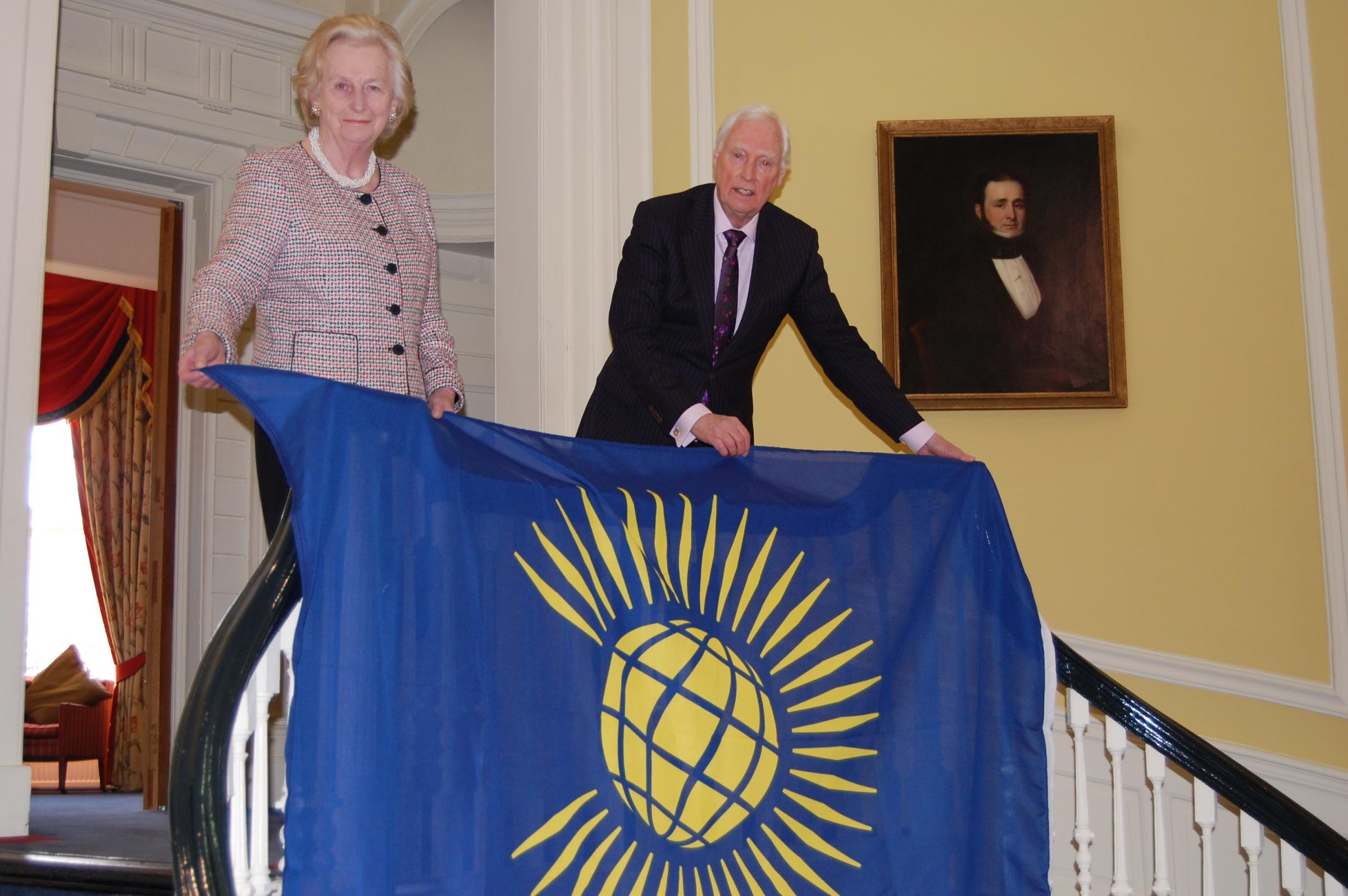 Lord-Lieutenant of Hampshire, Dame Mary Fagan and Hampshire County Council chairman Cllr Ken Thornber with the Commonwealth flag.