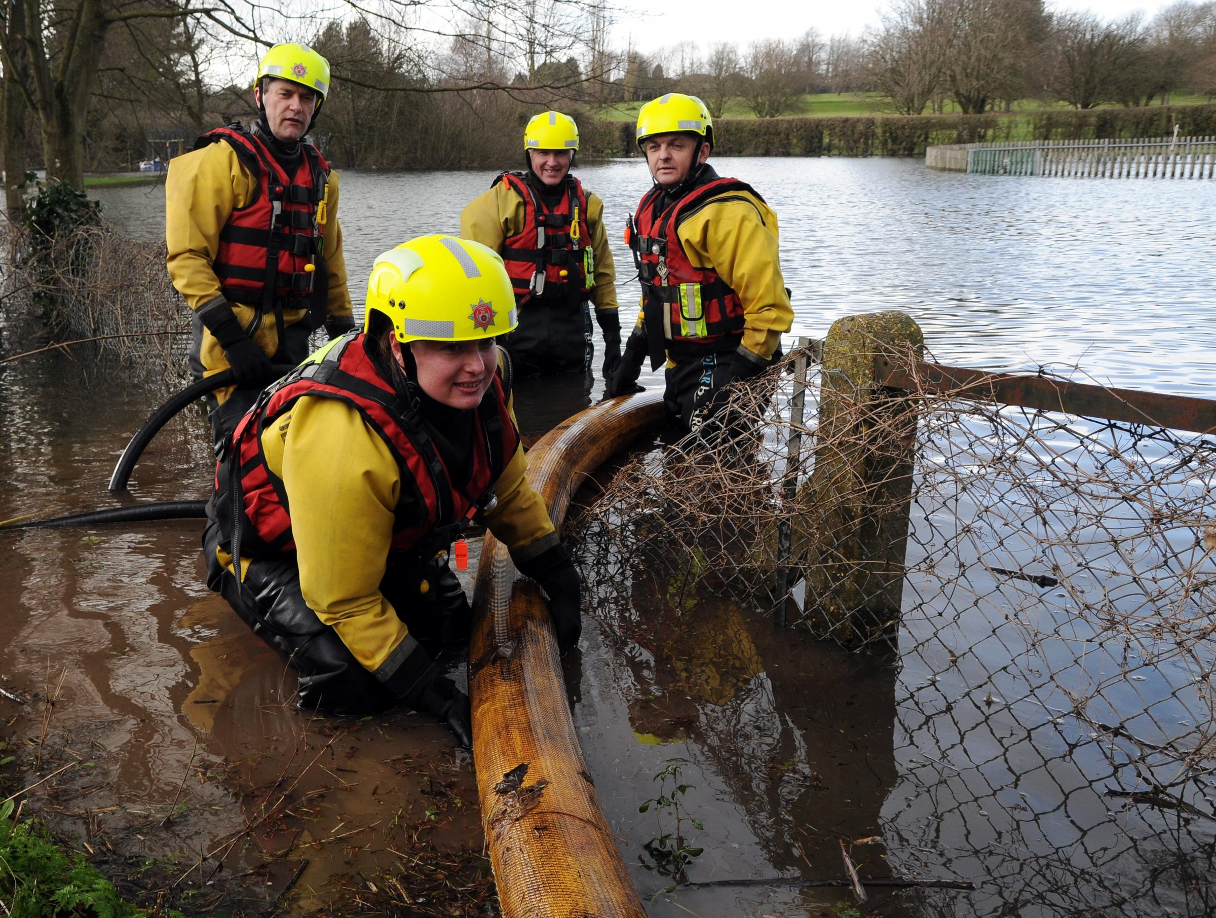 Hampshire Fire and Rescue personnel try to pump water from the sub-station.
