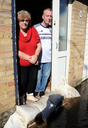 Tina Carrington and John O'Brien in their flooded Exmoor Close home.