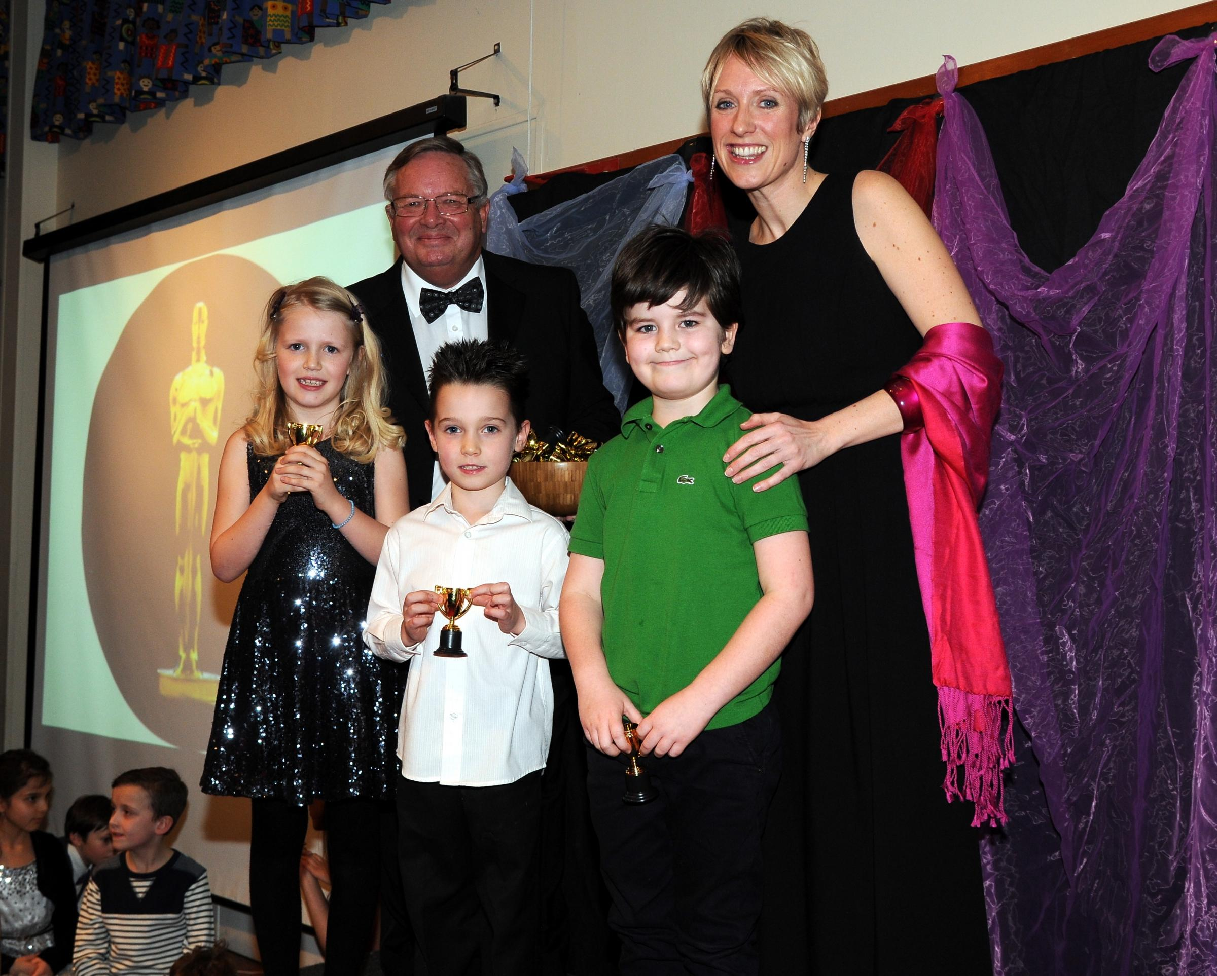 Chairman of the governors Peter Mitchener and headteacher Libby Wyatt, with Year 2 pupils Lucy, Charlie and Gene