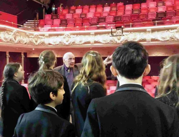 Basingstoke Gazette: Pupils from The Westgate School were shown around the theatre by local historian Phil Yates