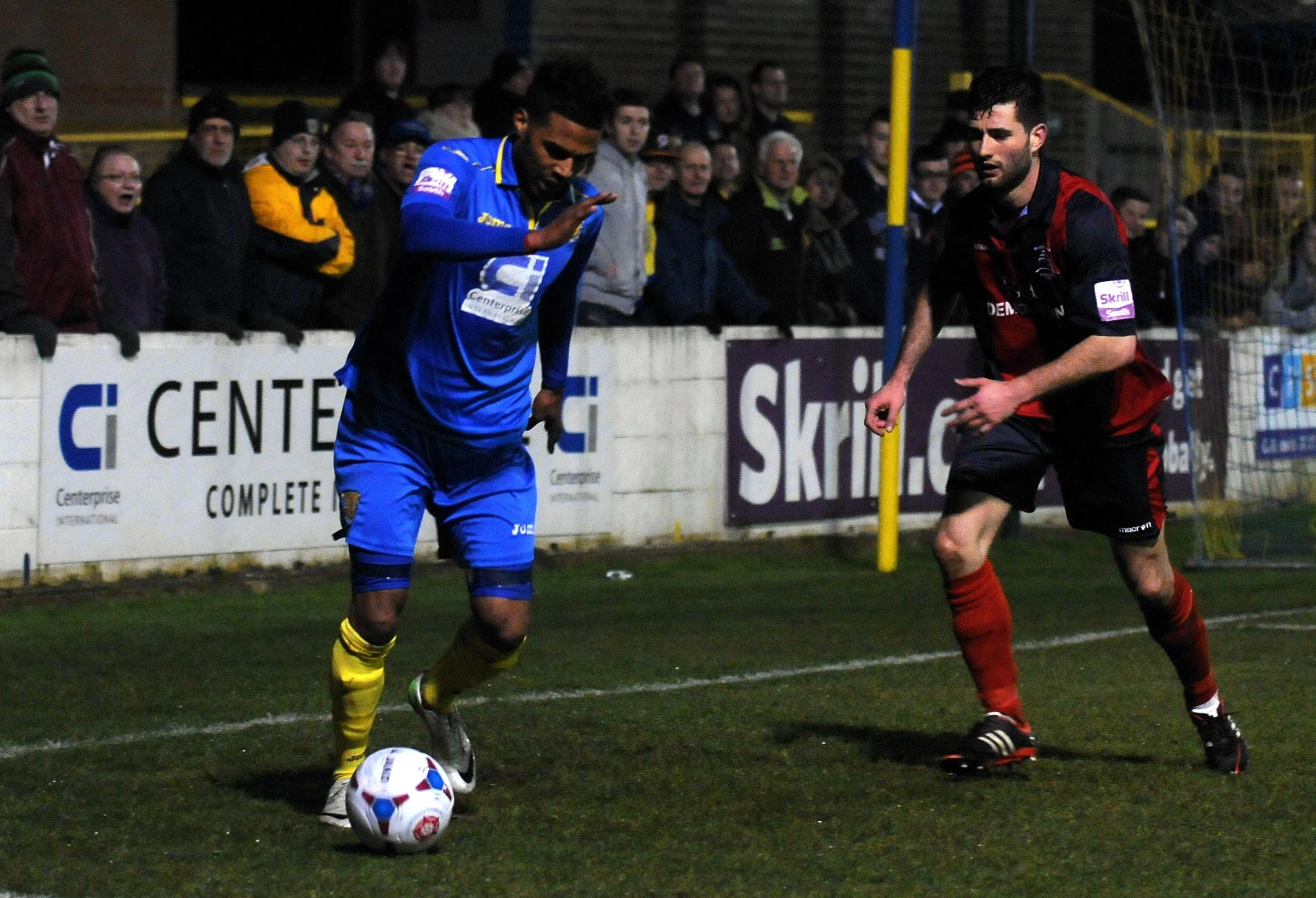 Town goalscorer Louie Soares takes on the Eastbourne defence.