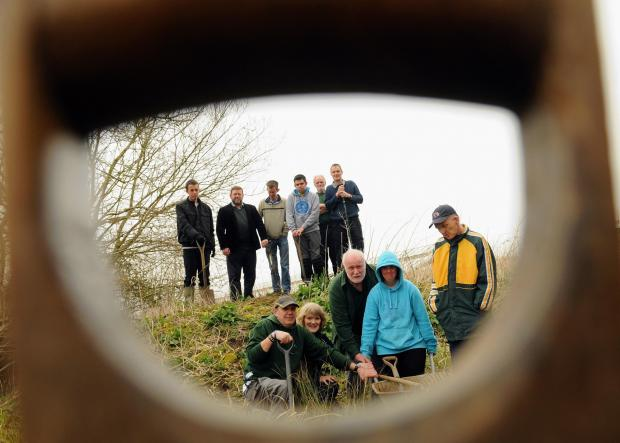 Volunteers at work creating the wildlife haven in Kingsclere.