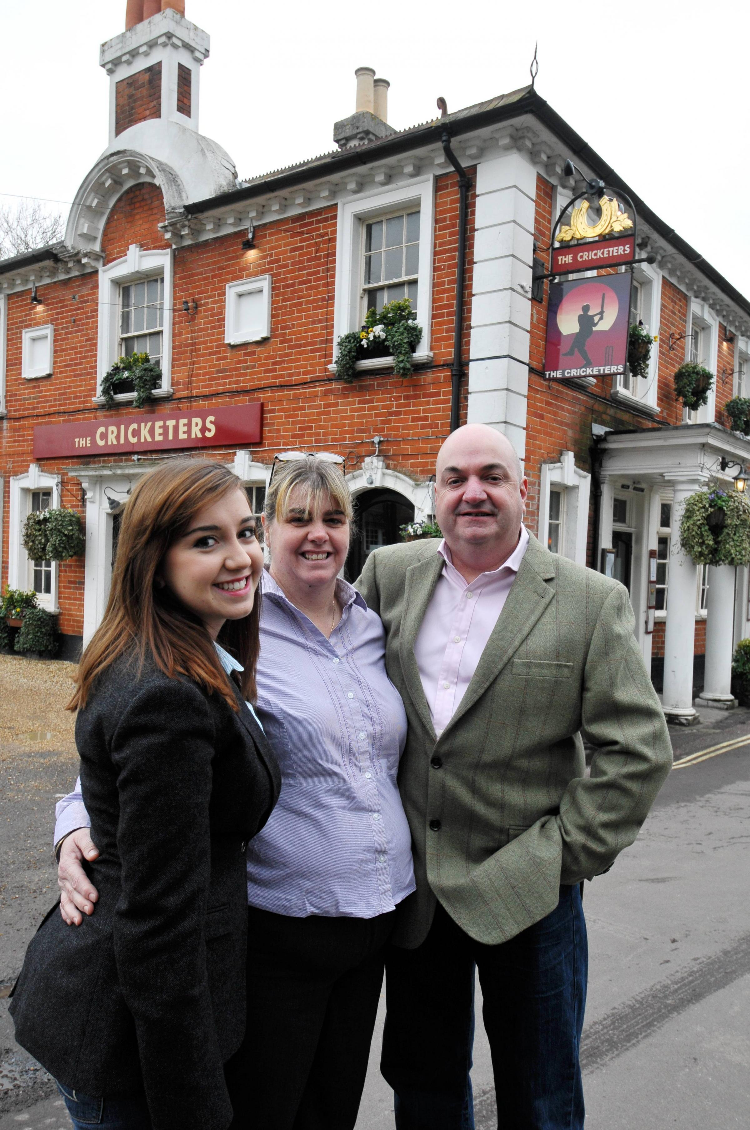 Amelia Thornhill with parents Penny and Mark. The family are leaving The Cricketers at the end of the month to take over a pub in the New Forest