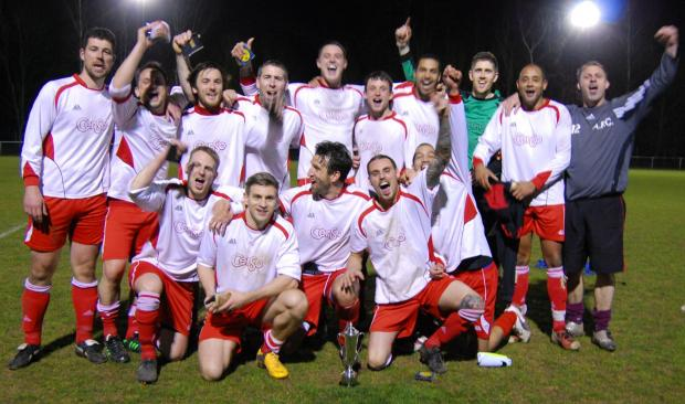 New Inn celebrate after winning the North Hants Intermediate Cup.