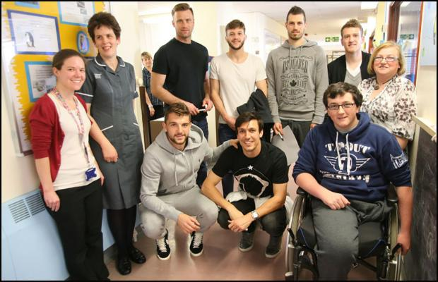 Saints stars put smiles on faces of kids in hospital