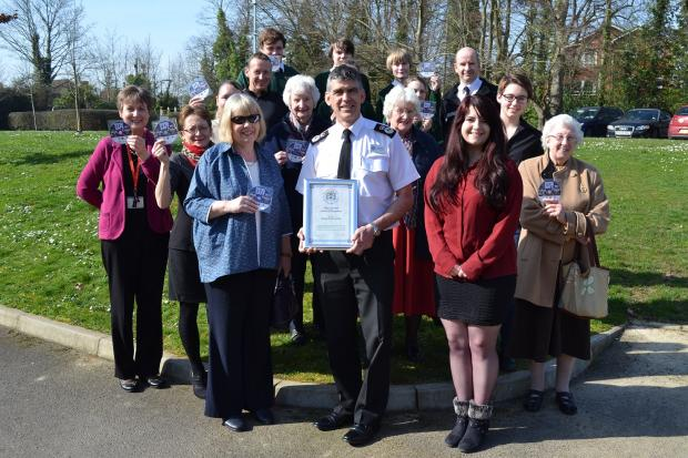 •	Cllr Liz Fairhurst, Executive Member for Adult Social Care and Public Health at Hampshire County Council (front left) and Chief Constable Andy Marsh (front centre) with the creators of the Keeping Safe DVD