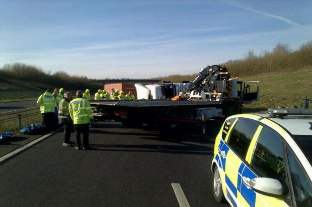 Officers work to recover the lorry. Picture from Thames Valley Police