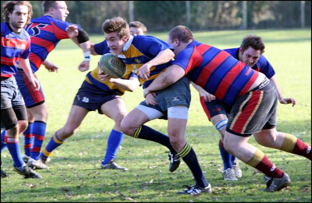 TWO TRIES: Dan Penn-Newman (with ball) helped Romsey to a vital victory at Overton.