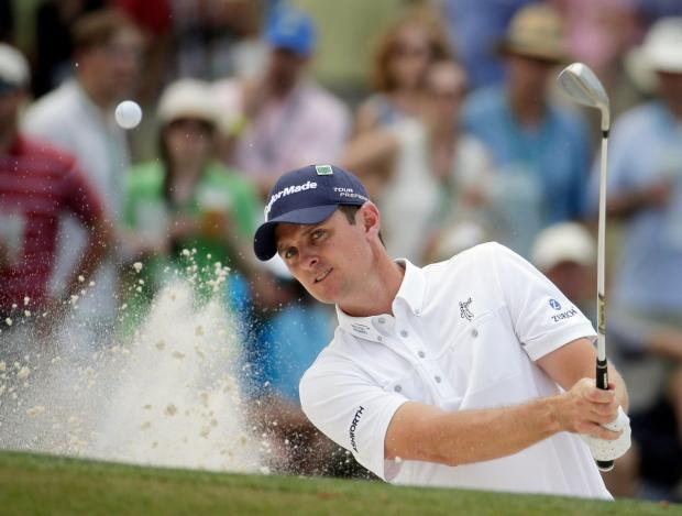 Justin Rose hits out of a bunker during his final round at Augusta
