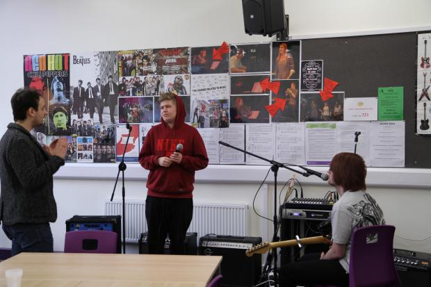 Tommaso Rossato sharing some technical singing techniques with students Coinnanch Hurford and Connor Kinghan