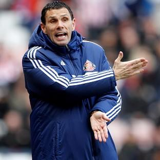 Basingstoke Gazette: Gus Poyet has dismissed online rumours that he could resign from his role