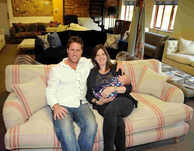 Basingstoke Gazette: Jason and Tracey Grout with baby Ivy, at Sofas & Stuff, Herriard Park