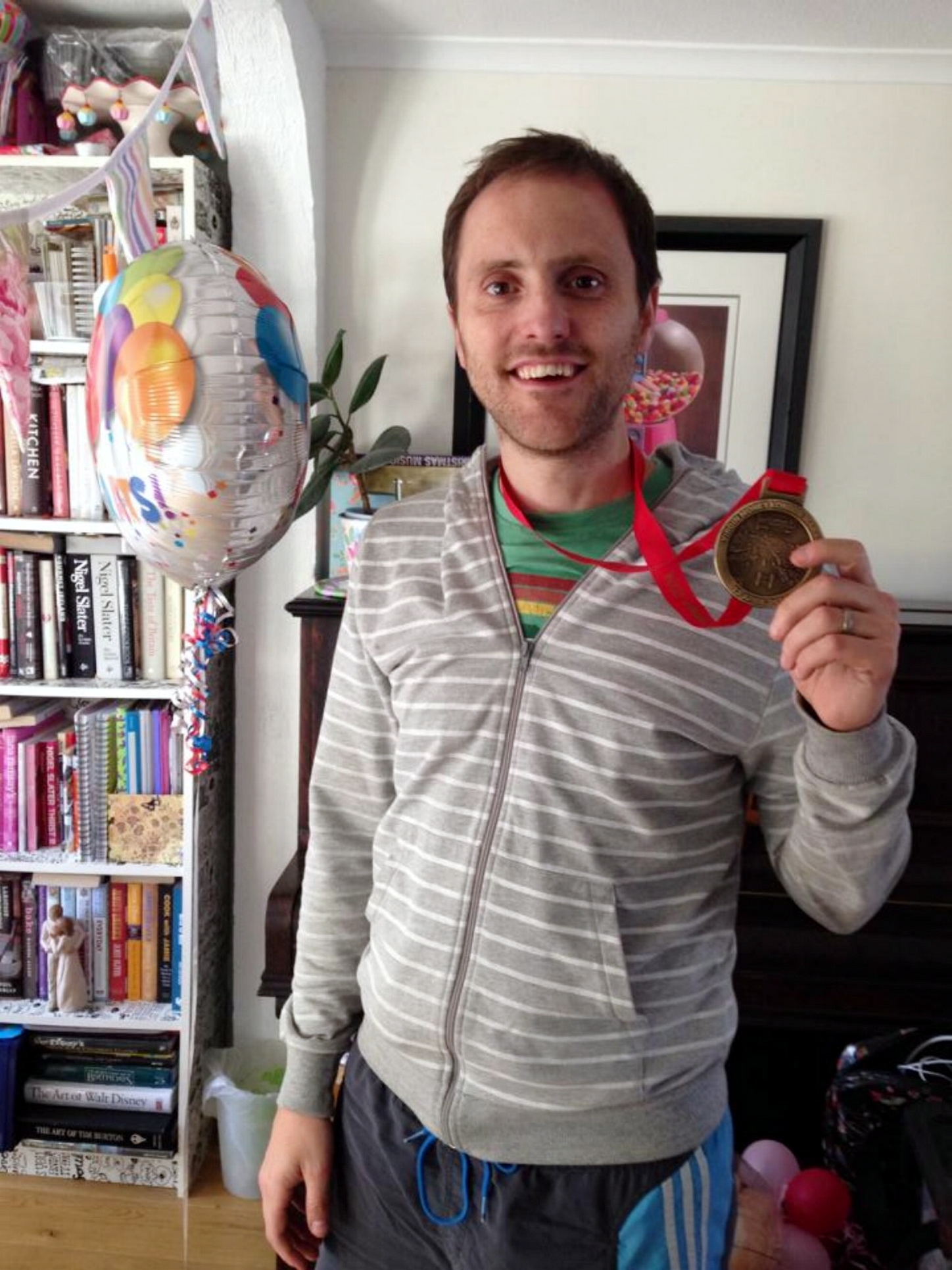 Paul Stamp back at home in Kempshott with his marathon medal.