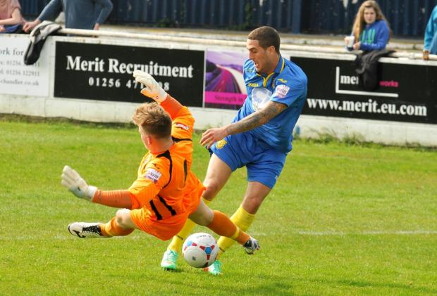 Basingstoke Gazette: Liam Enver-Marum rounds the Weston-super-Mare goalkeeper on his way to opening the scoring on Monday.