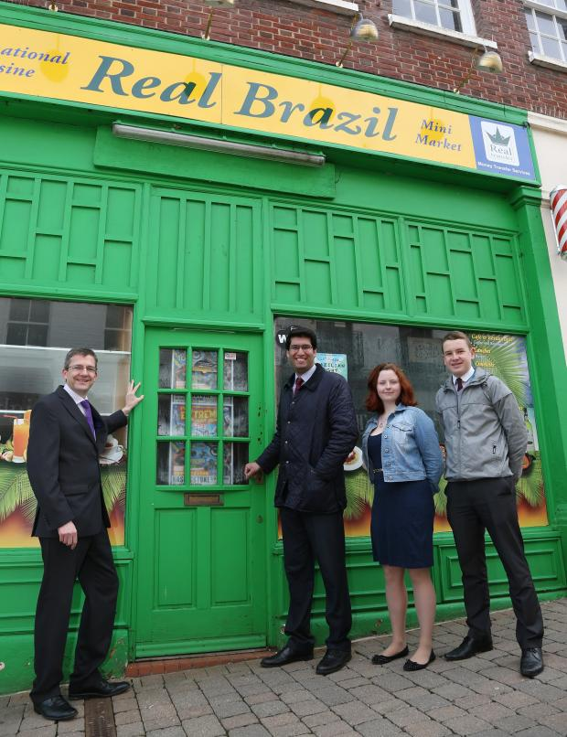Basingstoke Gazette: David Moir, deputy principal of BCoT, Cllr Ranil Jayawardena and BCoT apprentices Jessica Fuoco and Lewis Cooper outside the former Real Brazil restaurant.