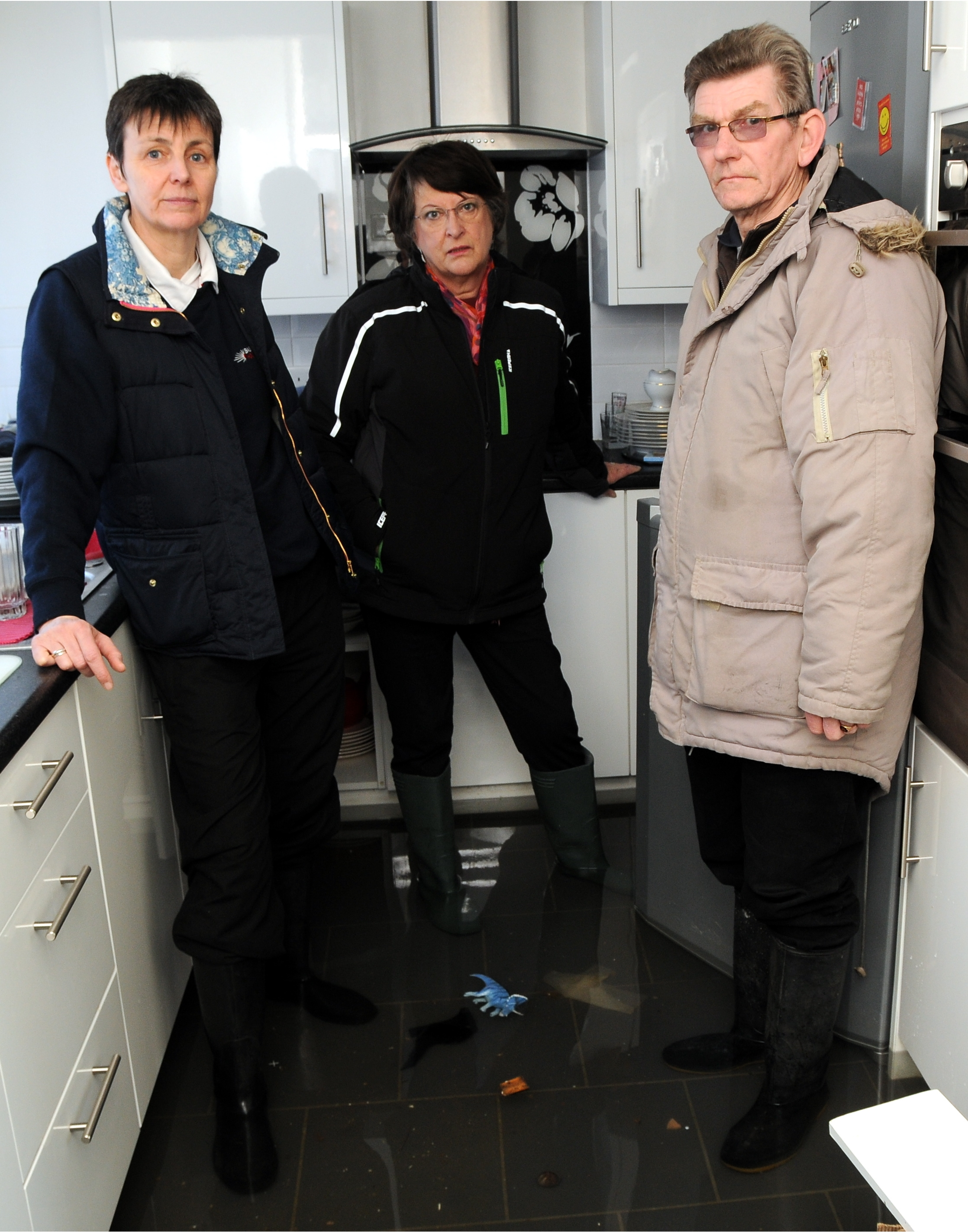 Liberal Democrat Janice Spalding, left, and South East Lib Dem MEP Catherine Bearder meet Buckskin flooding victim Charles Butt