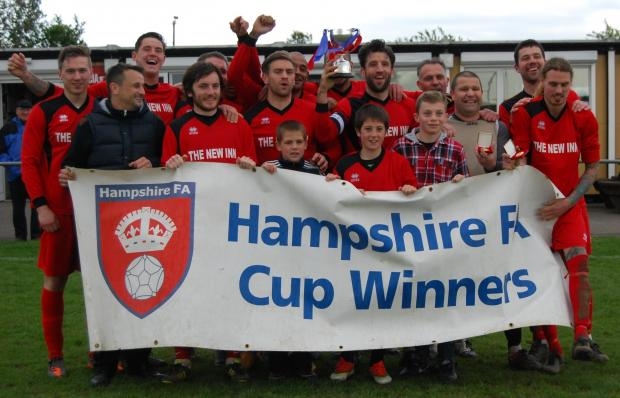 New Inn celebrate after winning the Hampshire Junior A Cup.