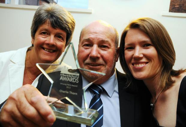 Basingstoke Gazette: Charlie Thorn, who won the 2013 Unsung Hero Award, with partner Brenda Shelbourn, and, right, Amy Mosdell, who nominated him