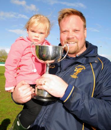 Basingstoke RFC director of rugby James Croker and daughter Lucy celebrate with the Hampshire Cup.