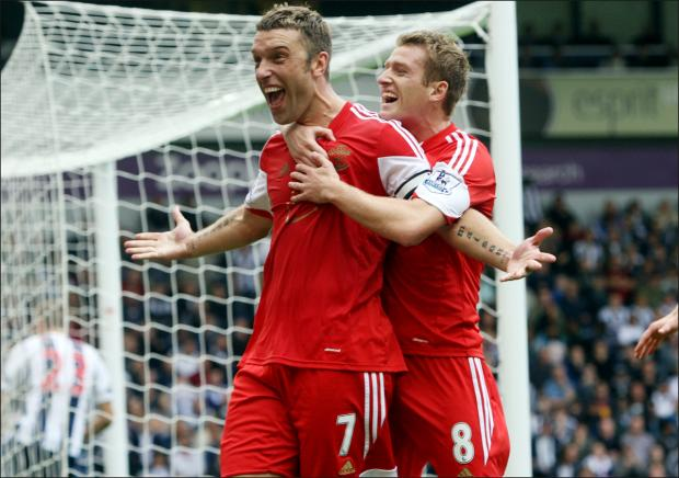 Rickie Lambert's goals have helped Saints bank £15.6m for finishing eighth in the Premier League
