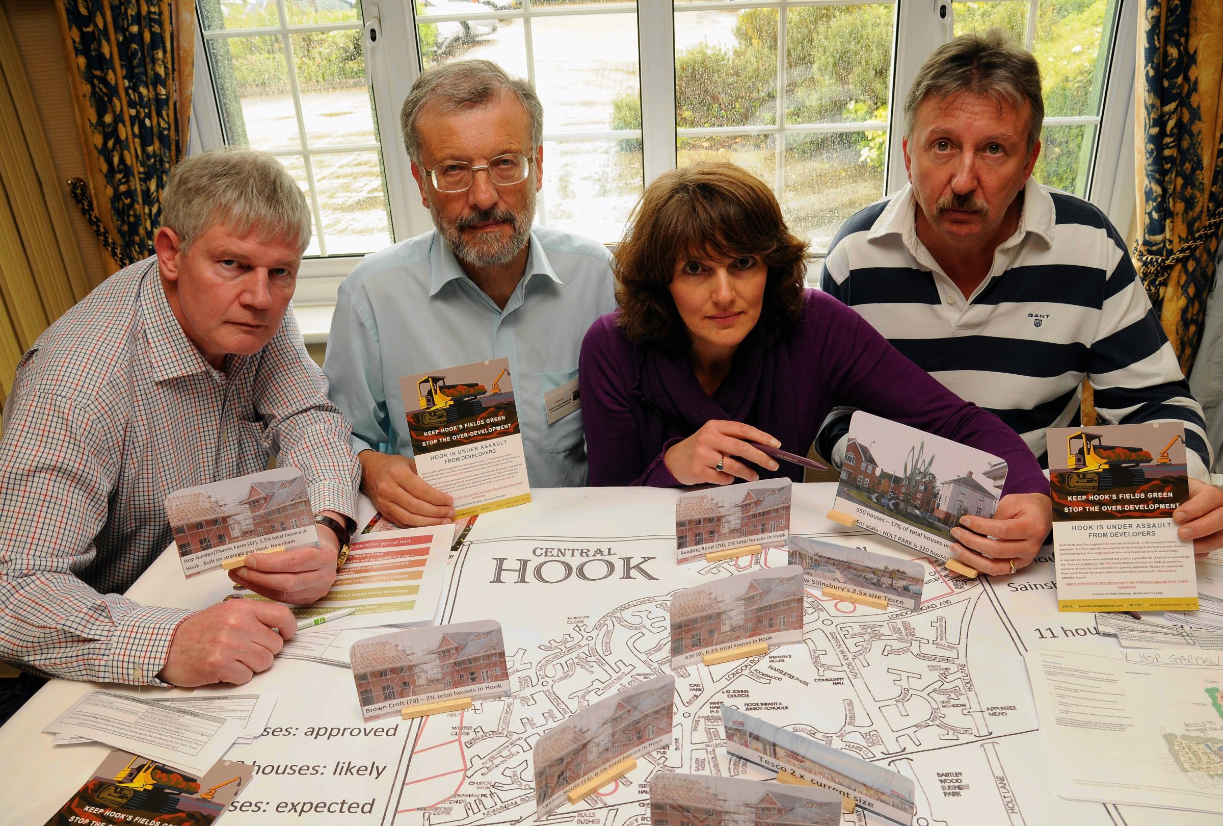 Nick Charles, Dave Lawrence, Sue Mesher and Steve Mesher, who are against over-development in Hook, take a look at the plans