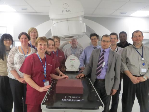 Basingstoke Gazette: Staff at the radiotherapy unit with the new linear accelerator machine