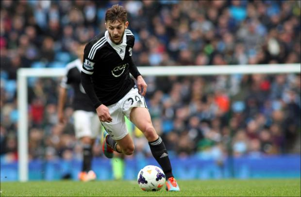 Basingstoke Gazette: Adam Lallana on the ball at the Etihad Stadium