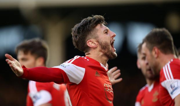 Basingstoke Gazette: Adam Lallana celebrates at Craven Cottage