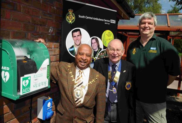 Basingstoke and Deane Mayor Cllr Dan Putty with Lions president David Fowler and Jeremy Dampney, of Tadley Communty Responders, at Tadley Community Centre