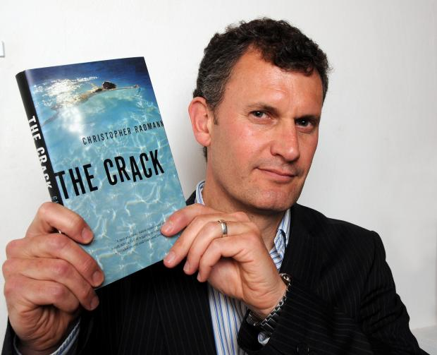 Christopher Radmann with his new book, The Crack