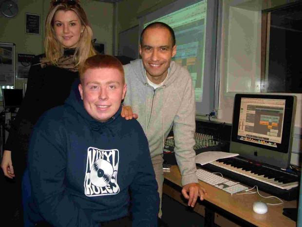 Student Ashley Hillier, front, with artist Chloe Davis and songwriter-producer Rohan Heath