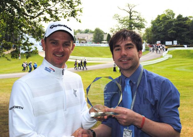 Justin Rose receives the Gazette Sports Personality of the Year trophy from sports reporter John Boyman