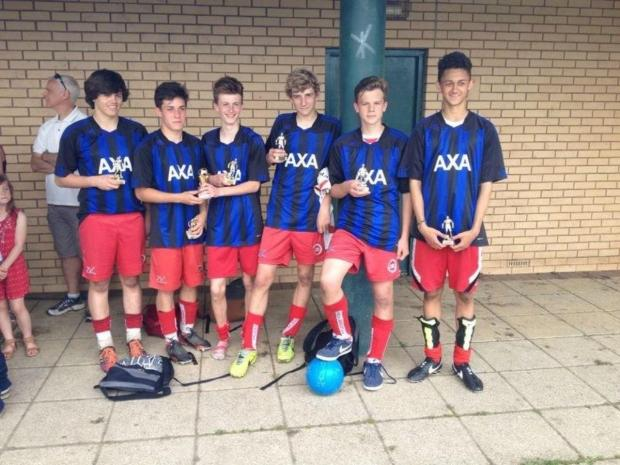 The winning CSA All Stars team with their trophies
