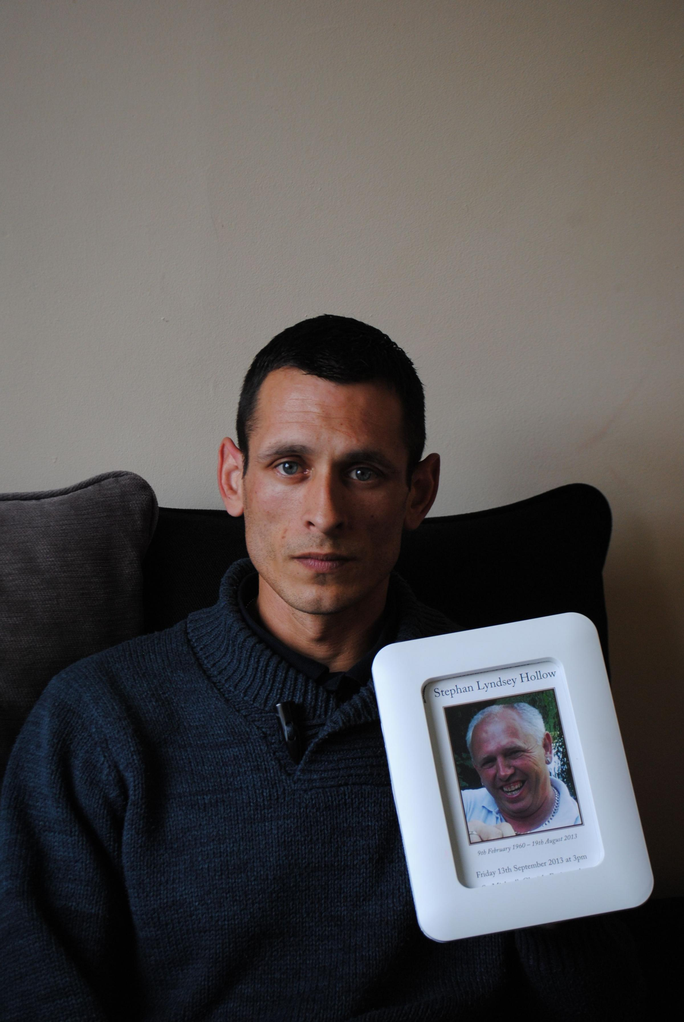 David Hollow with a picture of his father, Stephan.