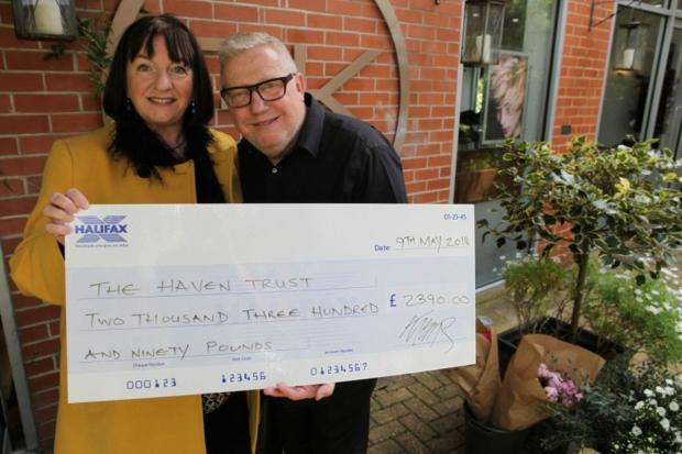 Lucy Cowie, Appeals Manager at The Haven Wessex is presented with a cheque by Guy Kremer